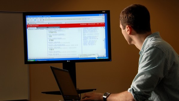 Student takes a class via computer. PHOTO BY ROGER WINSTEAD