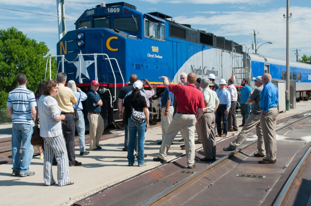 Lynn Harris (red shirt) of McDowell Engineers leads a tour of NCDOT's rail yard and train equipment.